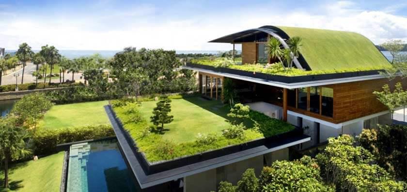 Ilustração de uma casa com um telhado verde